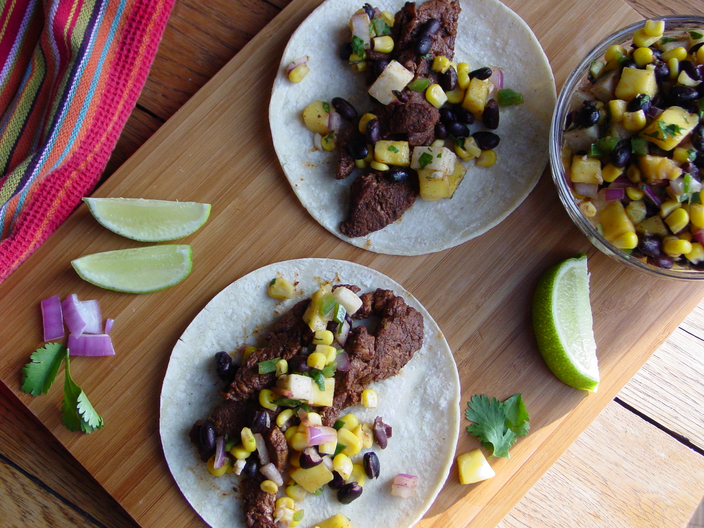Zesty Pork Tacos with Black Bean Mango Corn Salsa