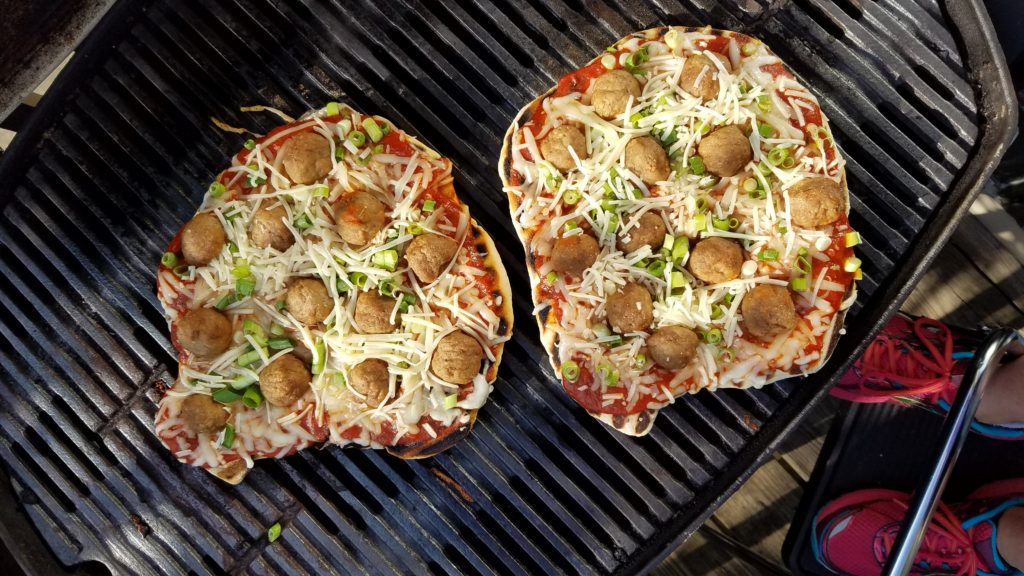Kid-friendly meatball pizza on the grill for family dinners, picnics and cookouts.